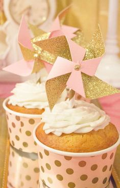 Pinwheel cupcakes at a pink and gold birthday party! See more party ideas at CatchMyParty.com!