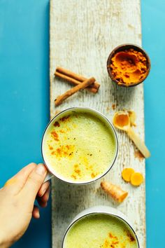 Creamy, 5-minute golden milk with dairy-free milk, ginger, turmeric, and coconut oil. Naturally sweetened, incredibly healthy, and so delicious.