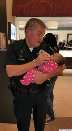 """As an experienced grandpa of 14, Officer Black knew what to do. """"I took the bottle, and I fed the baby,"""" he said."""