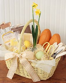 Gardener's Gift Basket Idea -- Add a pair of garden clogs, gloves, an apron, pruning snips and shears, seed packets, and plant labels. Round out the selection with a small plant and a sprinkling of colorful candies.