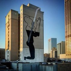 Silhouette mural on the side of a building at 54 Peachtree Street SW by Madrid-based artist sam3. Atlanta has a rich wall-mural culture with street artwork dotted around the city.