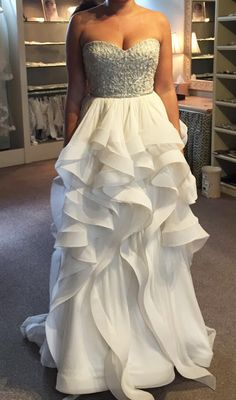 """Stunning dress purchased at a sample sale two months ago. CRYSTAL BEADING ON THE BODICE WITH SILK CHIFFON DRAPED SKIRT. Very flattering and so fun to wear. There are some minor flaws on the """"petals"""" o"""