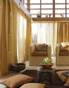 love the combination of sheer and gold curtains