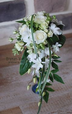 Cascade--ruscus, flax, and variegated lily grass- lavender rose/calla lily/stephanotis Small Wedding Bouquets, Cascading Bridal Bouquets, Cascade Bouquet, Bride Bouquets, Bridal Flowers, Floral Bouquets, Floral Wedding, Stephanotis Bouquet, Flower Decorations