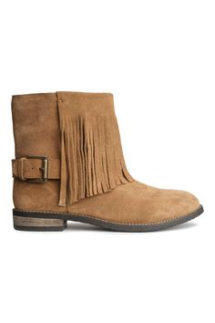 H&M  Jupe de longueur genou en tissu extensible. Modèle avec fine ceinture assortie en imitation cuir. Fermeture à glissière dissimulée et fente dans le dos. Doublée.