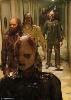 The zombies of the Darkness, left, face stiff competition from the mysterious inhabitants of the 13th Floor at Denver's Asylum Haunted House