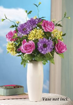 Rose and Daisy Floral Arrangement Bouquet - Adds a pop of color in all-white rooms.  Summer cottage decorating