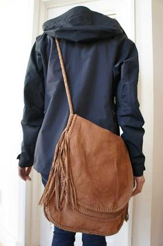 Lots of people use a hobo or messenger bag instead of a back pack.