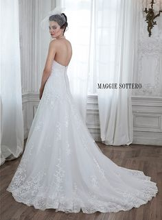 Romantic tulle A-line wedding dress with lace appliques cascading down to an embroidered hemline. Complete with subtle sweetheart neckline. Corrina by Maggie Sottero.