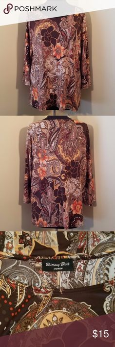"Orange & Brown Paisley Floral Blouse, XL Absolutely gorgeous floral and paisley in oranges, browns, cream and gold, 3/4 sleeve length blouse would be a beautiful addition to any wardrobe.   Great piece for the woman who travels with no-iron needed.   50"" bust, 27"" length.   Size XL Brittany Black (No tags) Brittany Black Tops Blouses"