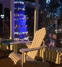 Tire Christmas tree lighting up the porch at the #tireshop #tiretree #adirondackchairs #smallbusiness #smsllbusinesslove #upcycled #tires #tireshoplife