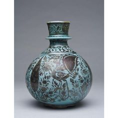 Date: mid- to late seventeenth century Culture: Iran Dimensions: 8 1/16 x 6 3/8 in. (20.5 x 16.2 cm) Medium: Stonepaste; underglaze-painted in turquoise; overglaze-painted in luster Object Number 48.310  Location: NEVADA MUSEUM OF ART (NMA) - See more at: http://www.shangrilahawaii.org/Islamic-Art-Collection/Search-The-Collection/?id=4376#sthash.aJpopOh3.dpuf