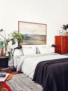 Decorating the bedroom - Replace your headboard with an oversize statement art piece