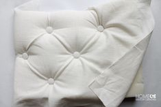 Tufting a backing for a chair