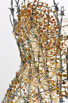 Flame Corset made of glass and barbed wire by Diana Dias-Leão