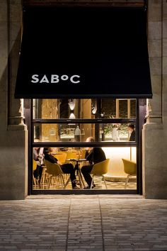 Chic Barcelona Restaurant by Adam Bresnick architects-cozy and chic, with an artistic approach towards colors and textures, materials and shapes. Retail Facade, Shop Facade, Retail Signage, Cafe Bar, Cafe Shop, Design Bar Restaurant, Hotel Restaurant, Cafe Design, Store Design