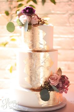 Buttercream wedding cake with edible gold leaf and fresh flowers. — HoneyLove Cakery