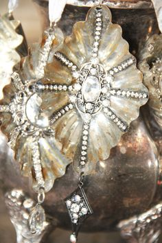 Our beautiful vintage tart tins have been given new life with beads, rhinestones and crystals. (The ornament featured in this listing is for the first and second photos above). Each ornament was hand finished with a real rusted patina and hand embellished with rhinestones, jewelry, crystal beads and crinkle ribbon, truly one of a kind. We use vintage findings and jewelry to finish most of our holiday ornament collections, so no two are exactly alike. Please visit our entire collection in…