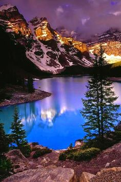 Situated in the valley of the Ten Peaks, Moraine Lake is a glacially-fed lake in Banff National Park, 14  km outside the village of Lake Louise, Alberta, Canada