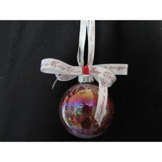 Handcrafted glass ornament that is red glitter lined with a white satin ribbon with Merry Christmas in red tied in a bow with a red snowflake ribbon. Fabric Ornaments, Ball Ornaments, Handcrafted Christmas Ornaments, Red Glitter, Glass Ball, Snowflakes, Merry Christmas, Gemstones, Holiday Decor