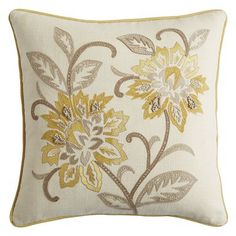 Characterized by fanciful plant and animal motifs, Jacobean embroidery first became popular in 17th-century England. Our cotton-covered  pillow comes alive thanks to the characteristic botanical design in subdued shades of yellow and gray atop a natural background.