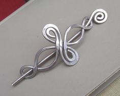 Celtic Shawl Pin / Hair Pin - Infinity Loops - Light Weight Aluminum Wire. $22.00, via Etsy.