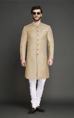 This Pastel Brown Achkan is perfect for day-time wedding ceremonies. Tailored and designed for an ambitious modern man, this Achkan features interesting tailoring details over bling and will make you look every bit elegant and sophisticated. Sherwani For Men Wedding, Wedding Dresses Men Indian, Wedding Dress Men, Indian Gowns Dresses, Wedding Suits, Mens Indian Wear, Indian Men Fashion, White Wedding Suit, Gents Kurta