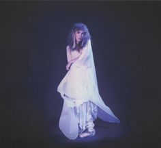 a beautiful photo of Stevie  ~ ☆♥❤♥☆ ~ a  dressed in her white chiffon ballet outfit wearing the outfit she wore for the cover of her debut solo studio 'Bella Donna' 1981 album, photo by Herbert W. Worthington 111  ~ love her uncertain expression and perfectly positioned feet  ~  https://en.wikipedia.org/wiki/Bella_Donna_(album)