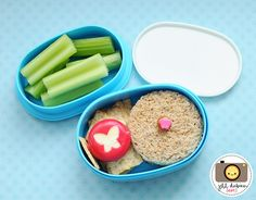 This was a bento for Kirsten's afternoon nutrition break. She had a circle shaped turkey bologna sandwich with a cute little pick. She also had some wheat thin crackers and a babybel cheese with a butterfly shape cut out of the wax. The top tier held some sliced celery.    MEET THE DUBIENS
