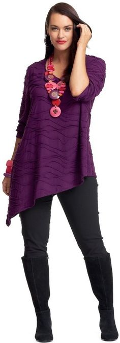 Asymmetrical top with slim leggings and boots yes... gaudy pink necklace, no