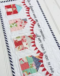 Patchwork Houses with bunting flags Julia Davis, RedRainbootsHandmade. Again I love the bunting and the embroidery but not sure how it would go in my quilt, but I want a beach hut in my central panel. House Quilt Block, House Quilts, Quilt Blocks, Quilting Projects, Quilting Designs, Sewing Projects, Small Quilts, Mini Quilts, Baby Set