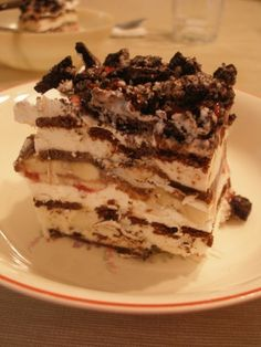 Ice Cream Sandwich Cake  ~~  This cake can be put together in 10 minutes flat. Ingredients: 24 ice cream sandwiches - 16 ounces of cool whip - 1 jar caramel sundae topping - 1 bag of your favorite candy, coarsely chopped Reeses peanut butter cups 	   	 (PLUS NO BAKING WHICH IS GREAT)