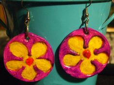 "2010-""Clay Far Out Flowers1"" earrings. I used a light layer of Air Dry Clay and a flower stamp, along with acrylic paint and a glossy finish for this set. Very cool, but next time, I think I'll do both sides."