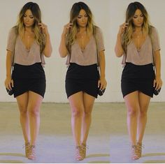 0f44838872be7 Loose plunging v neck crop top + asymmetrical black skirt + sandal heels  Hot Outfits