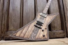 Hutchinson Guitar Concepts has finished one of their masterpieces: a Viking Explorer that tells the story of the warrior Sigurd battling the dragon, Fafnir. And no dragon could be slain without the addition of custom Black Winter pickups.