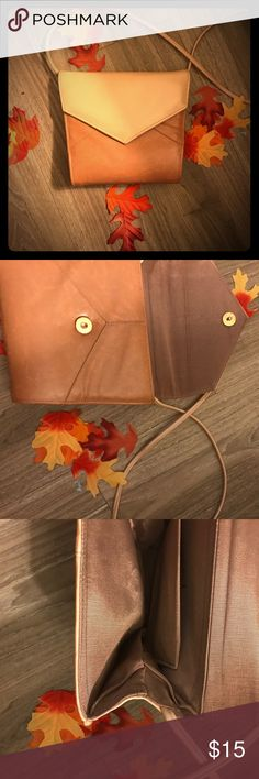 Vintage real 2-toned leather purse Unique vintage find, genuine leather in 2-tones: Brown and light tan, The latter of which is the color of the strap as well. Perfect earth tones for autumn and fall. Magnetic seal envelope shape yet unique two other envelope type purses including the fact that it has spacious room and expands and has an inside pocket. The interior is a shiny bronze material. ✨⚡️💫🌙 Bags