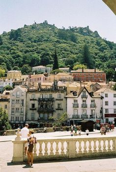 PORTUGAL – Sintra municipality, Grande Lisboa sub-region, Lisboa region. The view is towards the south from the Sintra National Palace at Largo Dr. Gregório de Almeida & Praça República. On top of the hill is the Castle of the Moors (Castelo dos Mouros). https://www.google.ca/maps/place/Sintra+National+Palace/@38.7976627,-9.3994101,15z/data=!4m5!3m4!1s0xd1edac0235d438d:0x74c0a6e0c1a71680!8m2!3d38.7976627!4d-9.3906554