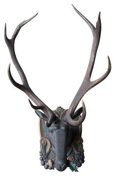 Wood Carved deer head ck: prefer these to the real ones...don't know if I would want them but I like them.