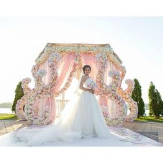 What a glorious way to exchange your vows under this floral art! wedding decor…