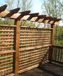 trellis tops off this gridded privacy screen...perfect for side of deck for privacy from neighbors