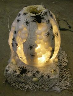 """Spider egg sac with pulse light and air wigglers at entrance. ----The kids had to reach in to get candy that year"""
