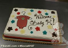 Social0187 | Baby Shower Cake | Custom photo cake with red, yellow, brown and teal daisies.