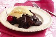 Slow Cooker Hot Fudge Brownies ingredients: 1 Reynolds® Slow Cooker Liner, 1 package (about 20 oz.) brownie mix, 1 cup chocolate syrup, 1 cup hot water