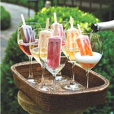 prosecco poured over fruit ice pops ~ who knew?
