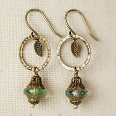 With echoes of handmade copper, earrings such as these feature antique brass in hammered hoops and paired with handmade Czech glass. - Antique brass finding and earwires (lead- and nickel-free) - Czec