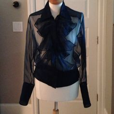 Gorgeous Gucci Ruffle Blouse! This top is very chic.  It is Blue in color and Sheer.  A great Date night blouse or evening out. Fits a size 6-8..  In excellent condition. From a smoke free home. Gucci Tops Blouses