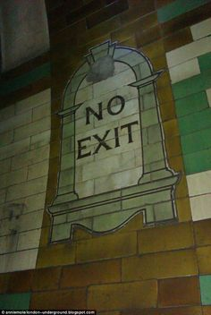 The disused London Underground Brompton Road Station. Decorative: A No Exit sign on the tiled wall inside the station, which was opened in 1906 to serve passengers on what was to become the Piccadilly Line