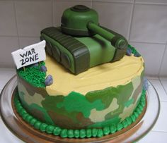 Camo Army Tank Cake - I made this cake for a little boy's 7th birthday. He loves Army stuff so I made a camo cake with a tank on top. The 10 in. cake is covered in buttercream and the tank is a shaped rice crispy treat covered in fondant. The kids at the party loved the cake but really loved the gumpaste rocks...they were fighting for them. Enjoy!!