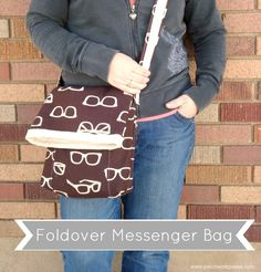 Foldover messenger bag tutorial for busy moms. Hidden pocket for kindle or ipad, inside pockets for supplies. Foldover style to keep it all secure.