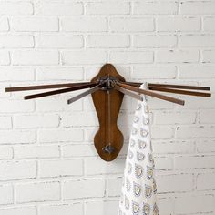 The Wooden Wall Mounted Drying Rack is made of wood and cast iron metal and mounts to the wall using screw holes. This rack is great for hanging tea towels, neck ties, scarves, and such. Wooden Drying Rack, Wooden Magazine Rack, Wall Mount, Vintage Laundry, Wooden Walls, Wooden, Vintage Farmhouse Style, Primitive Decorating, Farmhouse Wall Decor